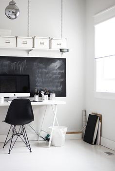 Blackboards - so aesthetically pleasing, and so useful! Eames chair in black is pretty. Love the line of boxes ahead, also.