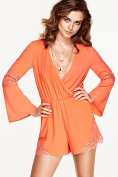 Airy coral orange romper with lace details, wrap front, and trumpet sleeves. | Party in H&M
