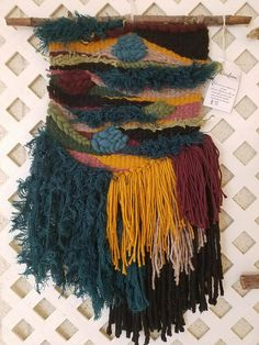 Darker jewel tone piece, with fun texture and color. Length: 21 Width: 15.5 (with stick)