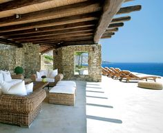#seafront #outdoor beachhouse #island resort Pinned for the wood beams and stone.