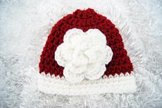 Sassy Newborn Baby Girl First Christmas Hat with Oversized Flower, Christmas Card Photo Prop. via Etsy.