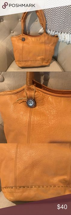 The Sak Shoulder Bag Mustard Yellow Shoulder Bag by The Sak.  In good pre-owned condition.  Handles and body of purse show no signs of wear.  Posted a picture of one small mark on back side of purse. The Sak Bags