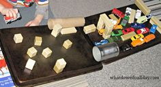 use baking sheets and magnet items to make an obstacle course ramp for toy cars