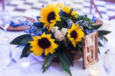 Sunflower and blue delphinium centerpiece by Love In Bloom Florist, Key West. Photo Megan Ellis Photography