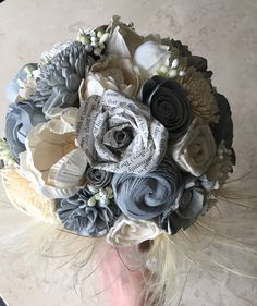 A personal favourite from my Etsy shop https://www.etsy.com/uk/listing/624367455/lovestory-book-paper-flowers-grey-and