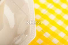 Saucer and Tablecloth - Saucer and tablecloth shot up close.