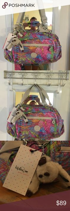 Kiplings coolest bag ever! New with tags Multi bright colors on smooth sturdy canvas with 2 handles & optional shoulder strap. Don't forget about the monkey keychain! Great bag, good size, perfect season for this beauty!! Kipling Bags Satchels