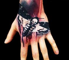 Hand tattoos for men and women can be considered to be the most popular tattoos ever worn by thousands of individuals all over the world. Moth Tattoo Design, Tattoo Designs, Tattoo Images, Tattoo Photos, Moth Tattoo Meaning, Collar Tattoo, Herren Hand Tattoos, Wicked Tattoos, Maori