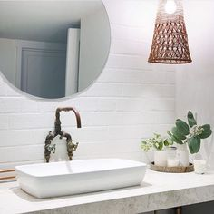 Grey marble top vanity, white square basin, industrial tap and mixer combo, round mirror. Project by - @westlaneinteriors #taps #interiordesign #bathroom #australia #architecture #bathroomcollective Visit our website for more www.bathroomcollective.com.au