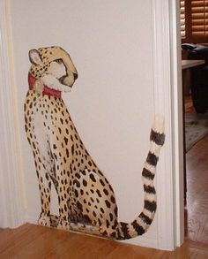 Pet cheetah painted on wall in home.
