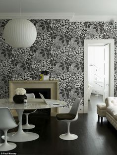 marthe armitage. Grey, black and white dining room with dark wooden floors and strong wallpaper