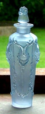 PAN - Lalique --   The design is of four Satyrs faces with trailing foliage.  c 1925.
