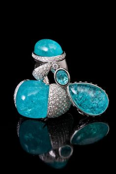 Cabochon Paraiba Tourmaline ring and pendant with diamonds, exclusively from TAYMA Fine Jewellery.