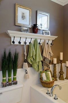 Replace ugly towel bars with pretty hooks that double as a shelf