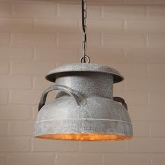 Milk Can Pendant in Weathered ZincA utilitarian farm piece has been transformed into a beautiful rustic pendant for your home. Imagine this piece inside the mudroom or in the kitchen. The possibilitie