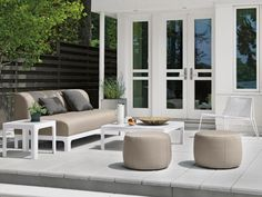 The stylish, modern  Crescent patio set  from Room and Board comes in a variety of colorful Sunbrella fabric options and its sleek lines set it apart from the patio furniture pack.