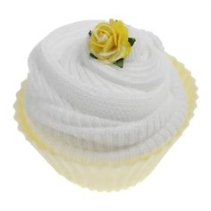 This practical baby gift is a sweet way of sending baby wishes.  Two pairs of soft cotton baby socks (size 0 - 0-6 months) are wrapped and presented in a reusable silicone cupcake case.