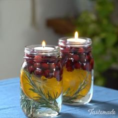DIY Holiday Table Decor  NEED:⠀ mason jars⠀ orange⠀ rosemary⠀ cranberry⠀ water⠀ tea lights⠀