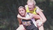 Teen carries injured competitor in race (video)