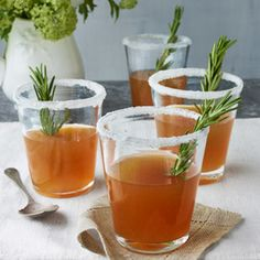 A verdant herb sprig, sugared rim, and dash of honey update these Rosemary-Infused Honey Sidecars. #easter #cocktail