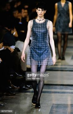 Model walking the Helmut Lang Spring 1992 RTW collection.