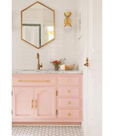Rose Gold Perfection | While the new tiles help make this space feel more modern, it's the little touches, such as gold hardware and a swipe of pink paint, that make this space really stylish. To cut costs, Larson decided to keep the original vanity, but she gave it a paint makeover. A low-contrast, soothing color palette may make a dated and cluttered room look deceptively fresh and tidy.