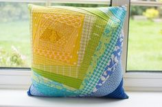 Lets Make Stuff's Bloomin quilt as you go pillow/cushion using yellow, green and blue fabrics.