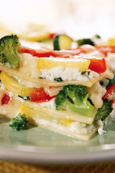 This vegetarian lasagna recipe is made with low-fat cottage cheese and fat-free ricotta. Bursting with colorful and healthy vegetables, it's a satisfying low-fat meal. #vegetarian #vegetarianrecipes #vegetarianfood #vegetarianideas #vegetarianmeals #vegetarianinspiration #vegetariancooking #recipe #eatingwell #healthy