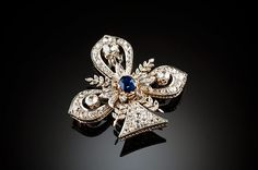 Large antique diamond and sapphire trefoil and foliate brooch in silver-topped gold. Circa 1880.