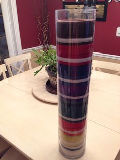 Karate belt display. 28 inch glass vase from home decor store.