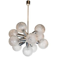 Mid-Century Modernist Sputnik Chandelier in Chrome and Textured Glass Globes | From a unique collection of antique and modern chandeliers and pendants at https://www.1stdibs.com/furniture/lighting/chandeliers-pendant-lights/
