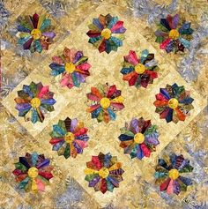 Edyta Sitar, author of the fascinating Friendship Triangles and Hop To It books, shows us a contemporary Dresden Plate quilt, using rich, deep batik colors.