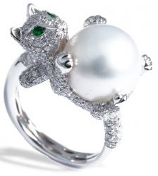 Mvee-WILD AT HEART-web-Apr.2013,   Unleash your playful spirit with this precious ring, featuring a dazzling white pave diamond kitten cradling a luminous south sea pearl. Green tsavorite accents.Dia: 2.48ct