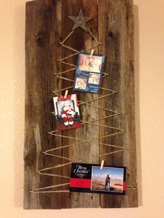 Christmas Card Holder.  So cute with the rustic look.  Reclaimed wood, twine and a cast iron star!  Clever home décor for the holidays or could be left up year round with pictures instead of Christmas cards.