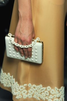 Bags and clutches are kind of a side note for me, i think its good to have a nice standard bag but I don't invest a lot of time on them. THIS HOWEVER, is a divine white star that I would invest in to have delicately hanging from my limp wrist. Valentino SS 2013
