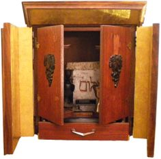 """Haunted Objects:  The Dibbuk Box (contains ancient, malevolent spirits) - According to Jewish folklore, a dibbuk box is a wine cabinet haunted by a restless, evil spirit with the capability of haunting and even possessing the living. The dibbuk box became famous in 2001 after the granddaughter of a 103 year-old woman auctioned off her grandmother's belongings. An antique dealer gave it to his mother who suffered a stroke, and while in the hospital, cried as she spelled out """"H-A-T-E-G-I-F-T."""""""