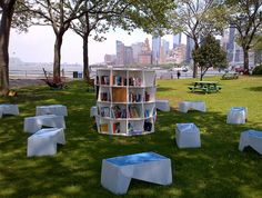 New York Public Library Brooklyn Public LIbrary Queens Library library lawn outdoor reading room on Governor s Island round bookshelf and wooden benches for sitting and reading pop up library open weekends provides library services summer 2013 Mini Library, Little Library, Dream Library, Open Library, Street Library, New York Public Library, Brooklyn Library, Public Libraries, Library Services