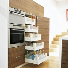 Small kitchen with wood flooring, veneer cabinetry, stainless steel appliances and storage drawers