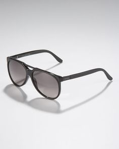 Round Sunglasses, Black by Gucci at Bergdorf Goodman.