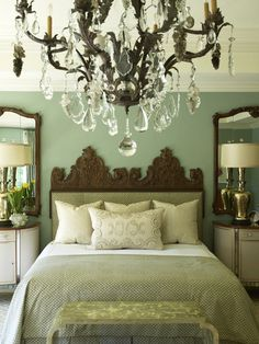 Mirrors above nightstands! Makes the room look so much bigger! I am going to do this for our new home for sure.