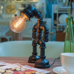 retro industrial style lamps made from reclaimed steel tubing and fittings
