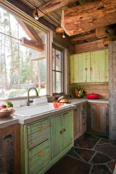 Love the bright open window and the mixture of distressed green with natural on the cabinets... love everything! SO wish this was my kitchen!