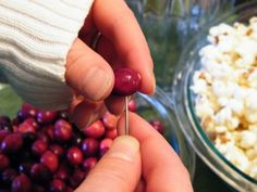 stringing popcorn and cranberries