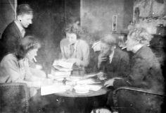 Holland, Jews in hiding, smoking and reading books.