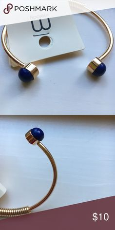Bracelet This is a modern gold bracelet with dark blue gems at the end. Brand new! Made for a smaller-medium wrist. I bought this at one of my local boutiques. ✌️ Jewelry Bracelets