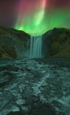 Veil of Light - A magical night in unforgettable conditions. Watching the Aurora Borealis dance above Skógafoss, I huddled over my camera like a human anchor, keeping the tripod from taking flight in winds that threatened to take the car doors off! Can't wait to do it again in October.