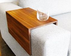"""They make a fantastic surface for a drink or laptop. No more precariously balancing items while you watch TV!"" Blisscraft says on Etsy.com.   ""We make these arm wraps by expertly laminating planks of solid wood lumber that we have dried, planed and cut.   ""Our arm wraps are not screwed, nailed or made with any kind of metal fasteners. They are as beautiful on the inside as they are on the outside, and will not mar your couch whatsoever."""