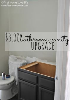 "$3 bathroom vanity makeover: The color sample is BEHR Premium ""Dark Cavern"" in a flat sheen. It's a dark charcoal color with an ever so slight hint of espresso."