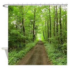 nature trail Shower Curtain. A photo of a nature trail for hiking into the deep forest surrounded by greenery.