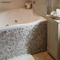Pebble bathroom - Beige pebble bathtub cladding. We produce pebble tiles - see our projects. We are looking for importers, interior designers, shops or distributors. See our full collection, others pebble tile, pebble cladding, standing pebble or pebble mocais products. Pebble tile for sale...  #pebbletile #pebbletiles #pebblemosaic #pebbles #pebblestone #beigepebble #indonesia #pebblewall #pebblebathroom